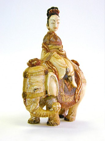 An ivory snuff bottle, in the form of a deity on an elephant